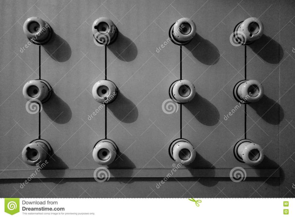 medium resolution of a black and white image of an old fuse box consisting of twelve circular ceramic fuses