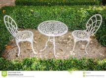 Vintage White Metal Table And Chairs In Garden Stock