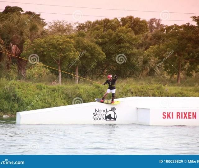 A Wake Boarder Waterskis Off A Flat Ski Rixen Ramp At Quiet Waters Park Deerfield Beach Florida
