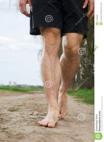 Black Man Walking Barefoot