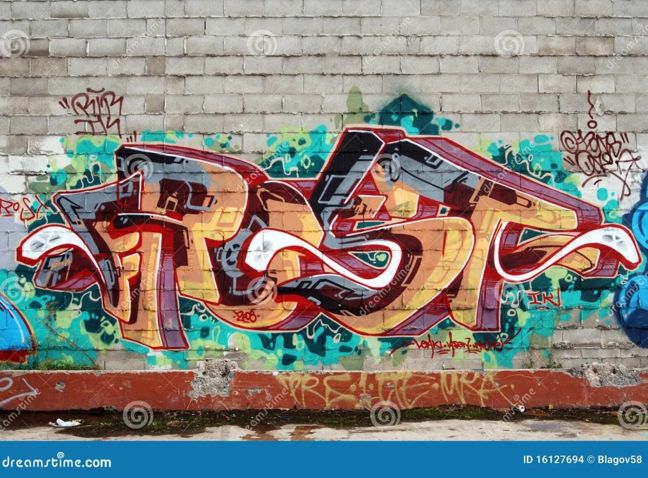 a wall vandalized with street graffiti art stock photo - image of