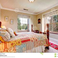 Old Fashioned Bedroom Chairs Mity Lite Folding Warm Colors With An Bed Stock Image