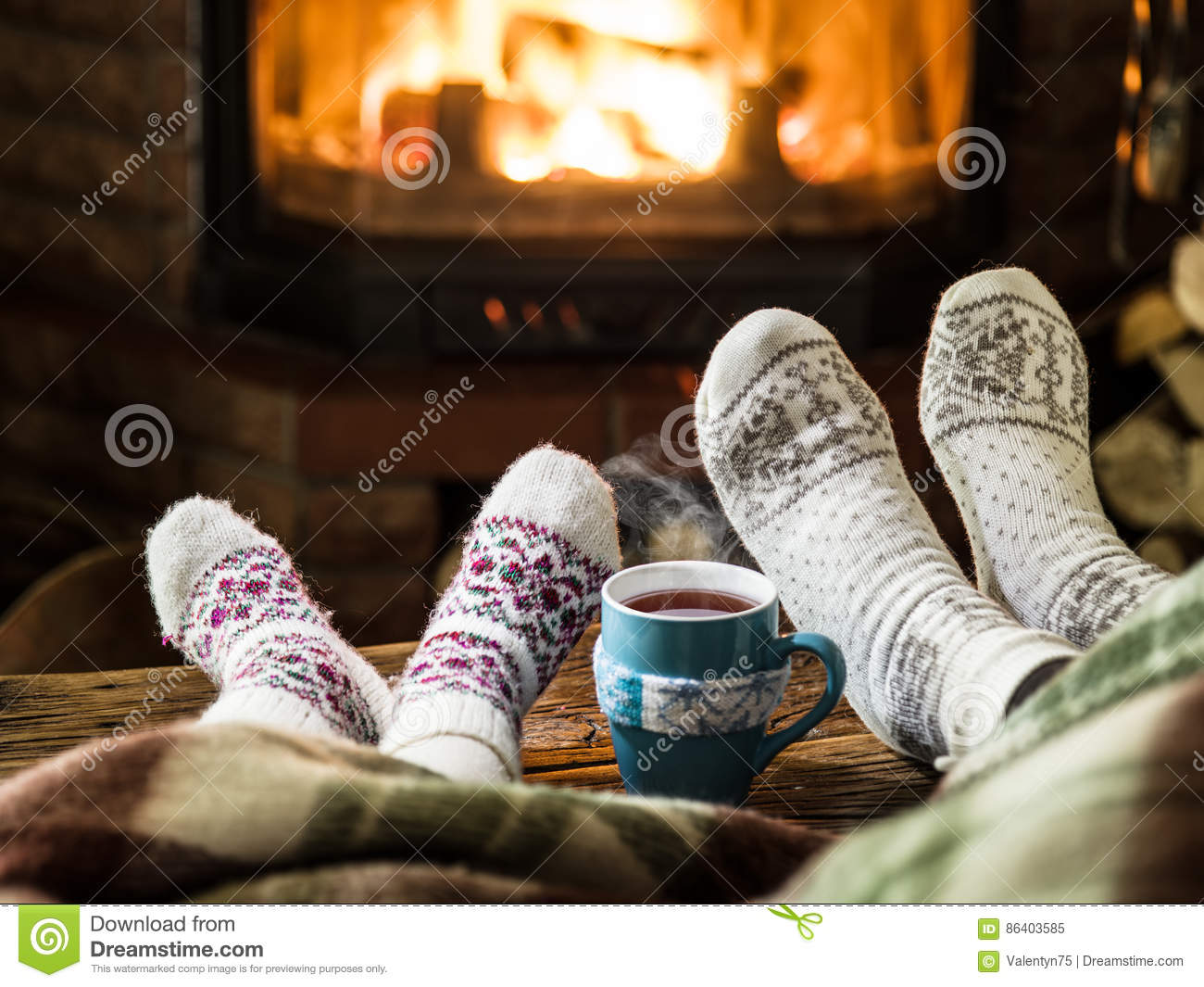 Couple Relaxing In Front Of Fireplace Man Looking At Woman Stock Man Relaxing With Hot Drink On Sofa Watching Tv Stock