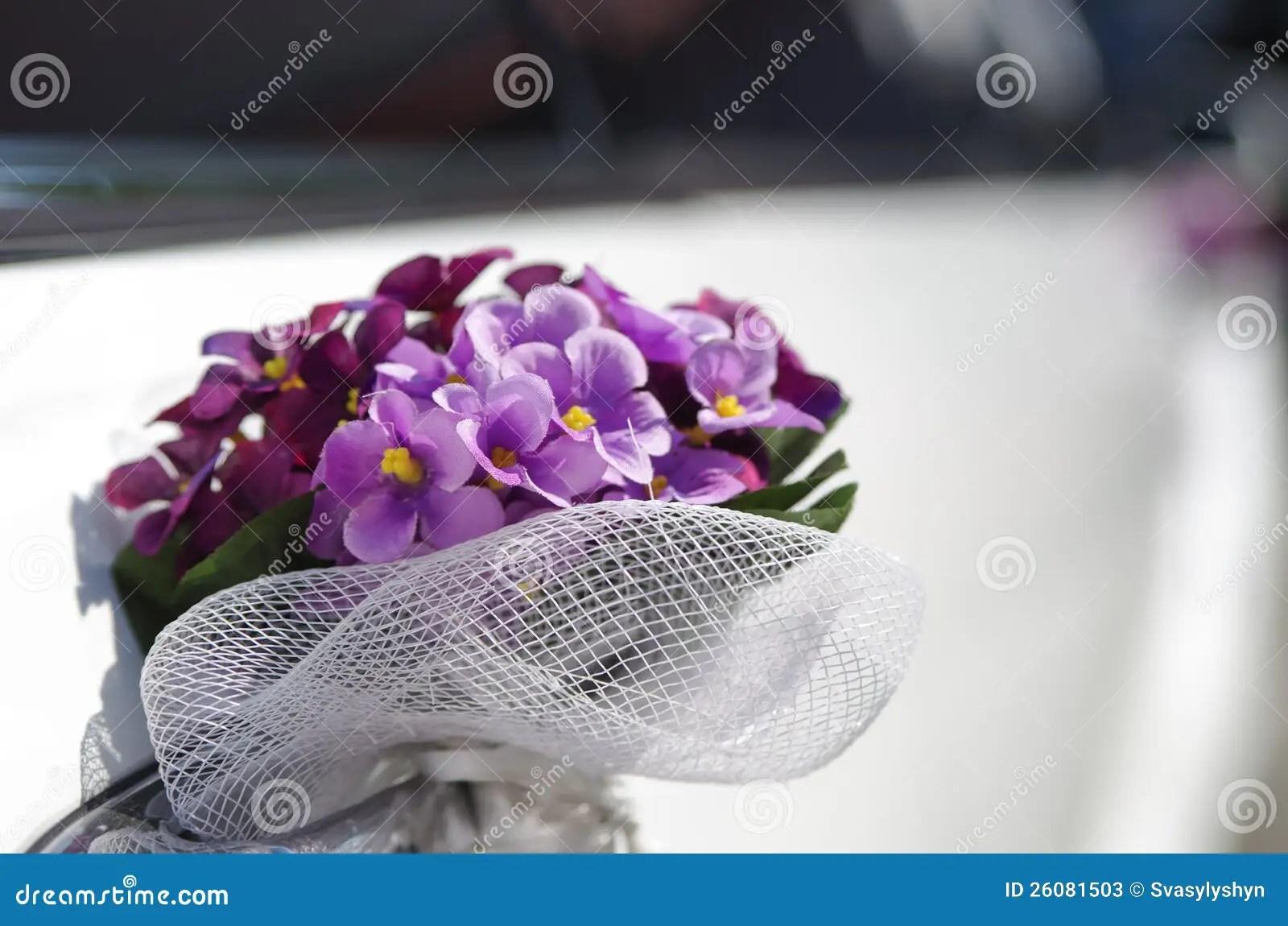 Wedding Bouquet On Limousine Door Handle. Bokeh Stock