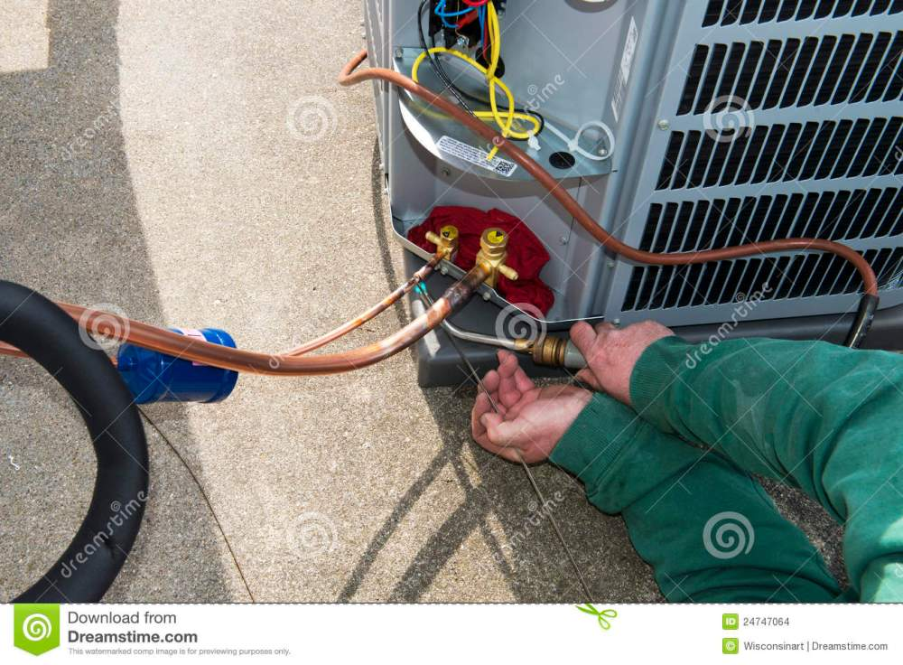 medium resolution of welding install central air conditioner ac unit stock photo image an ac service technician is