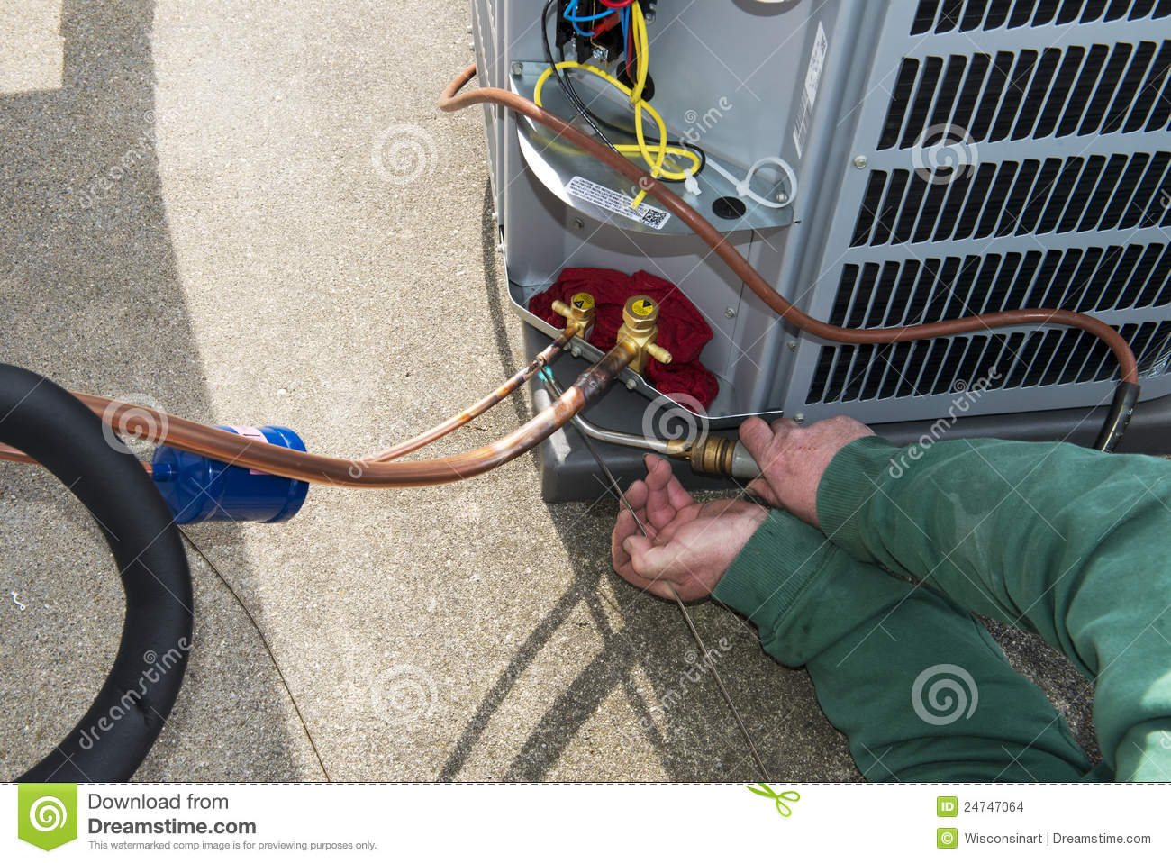 hight resolution of welding install central air conditioner ac unit stock photo image an ac service technician is