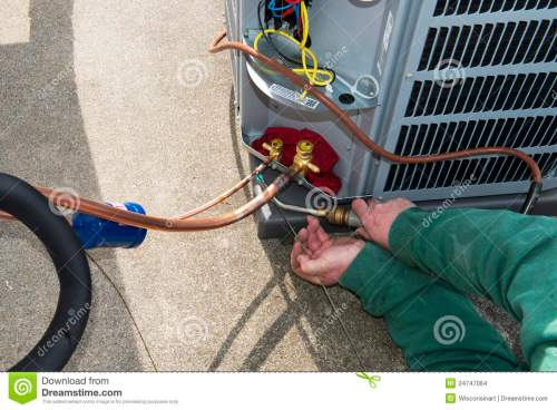 small resolution of welding install central air conditioner ac unit stock photo image an ac service technician is