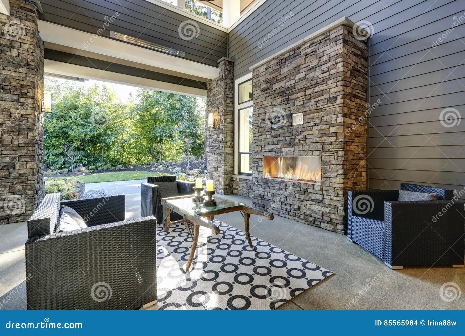 well designed covered patio boasts stone fireplace stock photo image of stone outside 85565984