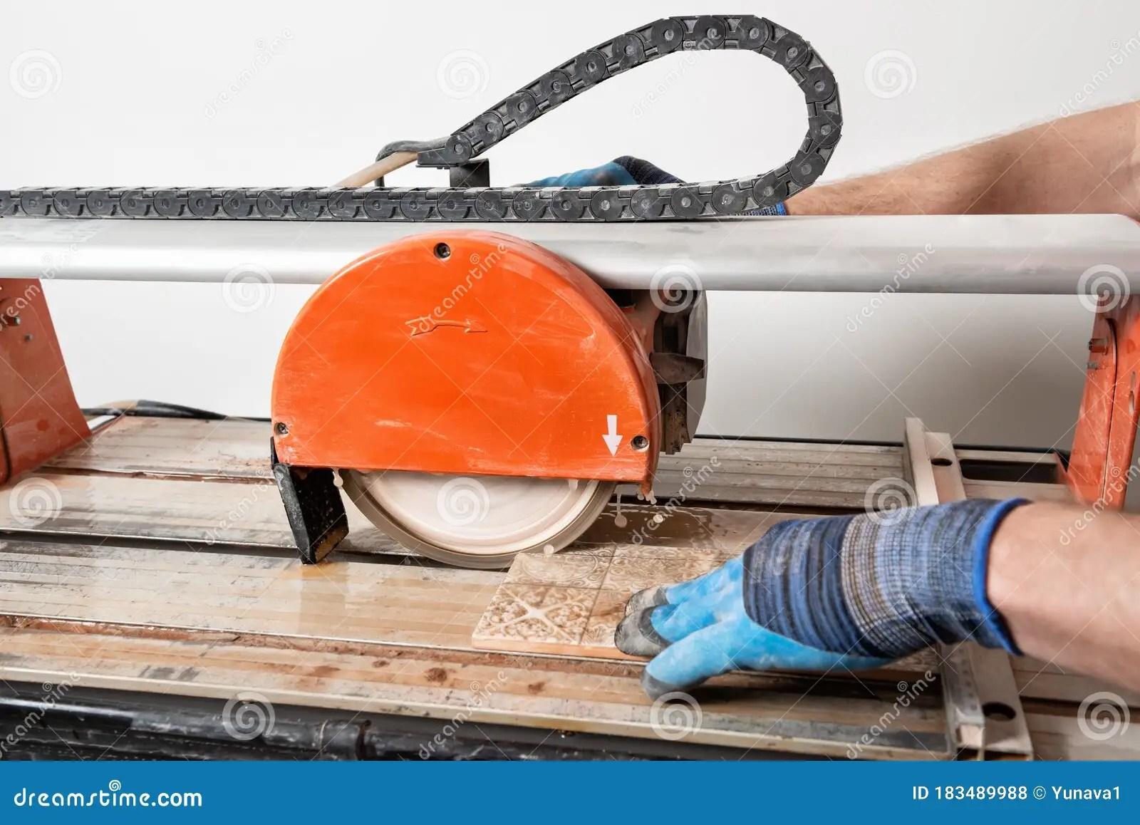 wet cutting a ceramic tile stock photo image of craftsman 183489988