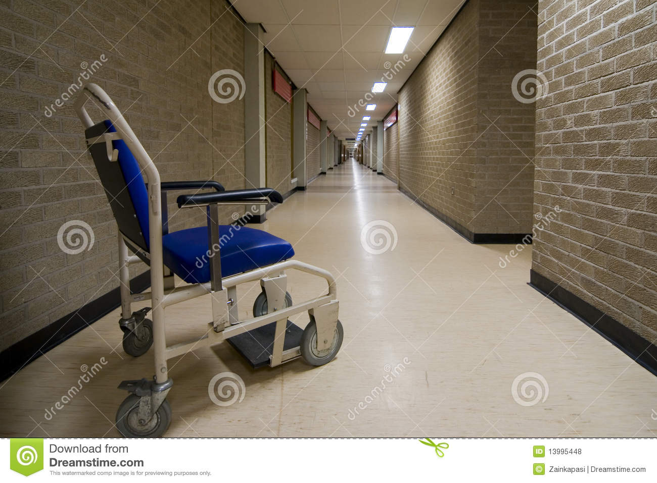 wheelchair nhs mickey mouse bean bag chair in an empty hospital corridor royalty free