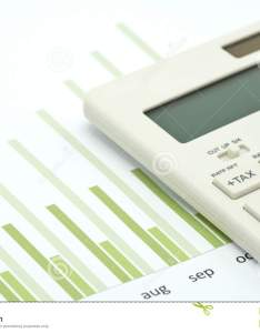 White calculator is placed on the performance sheet bar chart also rh dreamstime