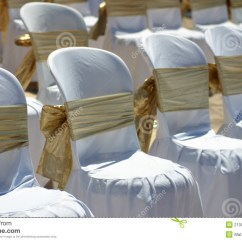 White Chairs For Wedding Home Goods Furniture With Gold Ribbon At A Beach Stock