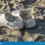 White Crocs On The Beach Stock Image Image Of Flipflops 175419681