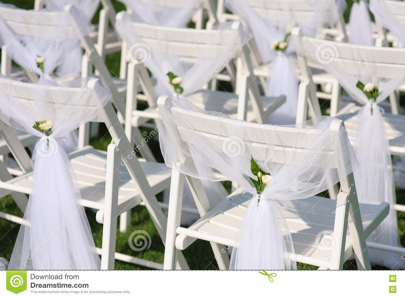 white chairs for wedding chair backs bleachers decorated on a green lawn stock photo image