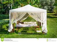 White Massage Tent Under A Green Palm Trees Stock Photo ...