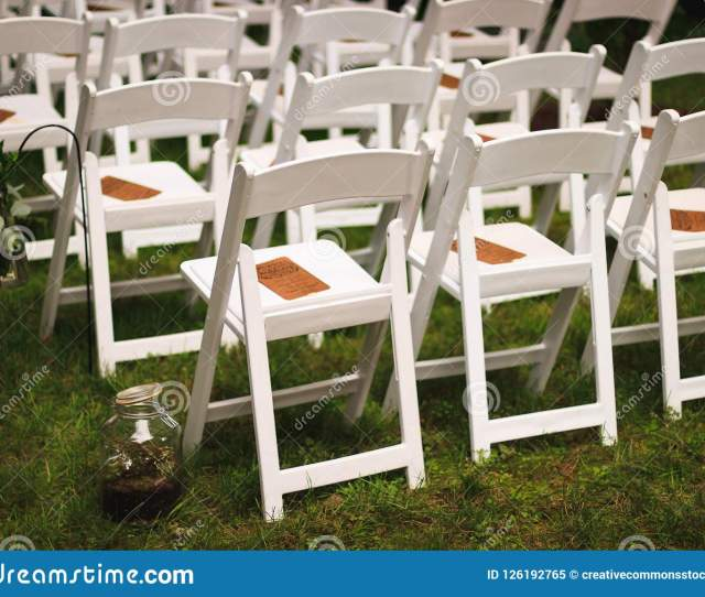 White Wooden Chairs On Green Grfield Free Public Domain Cc Image Download Preview