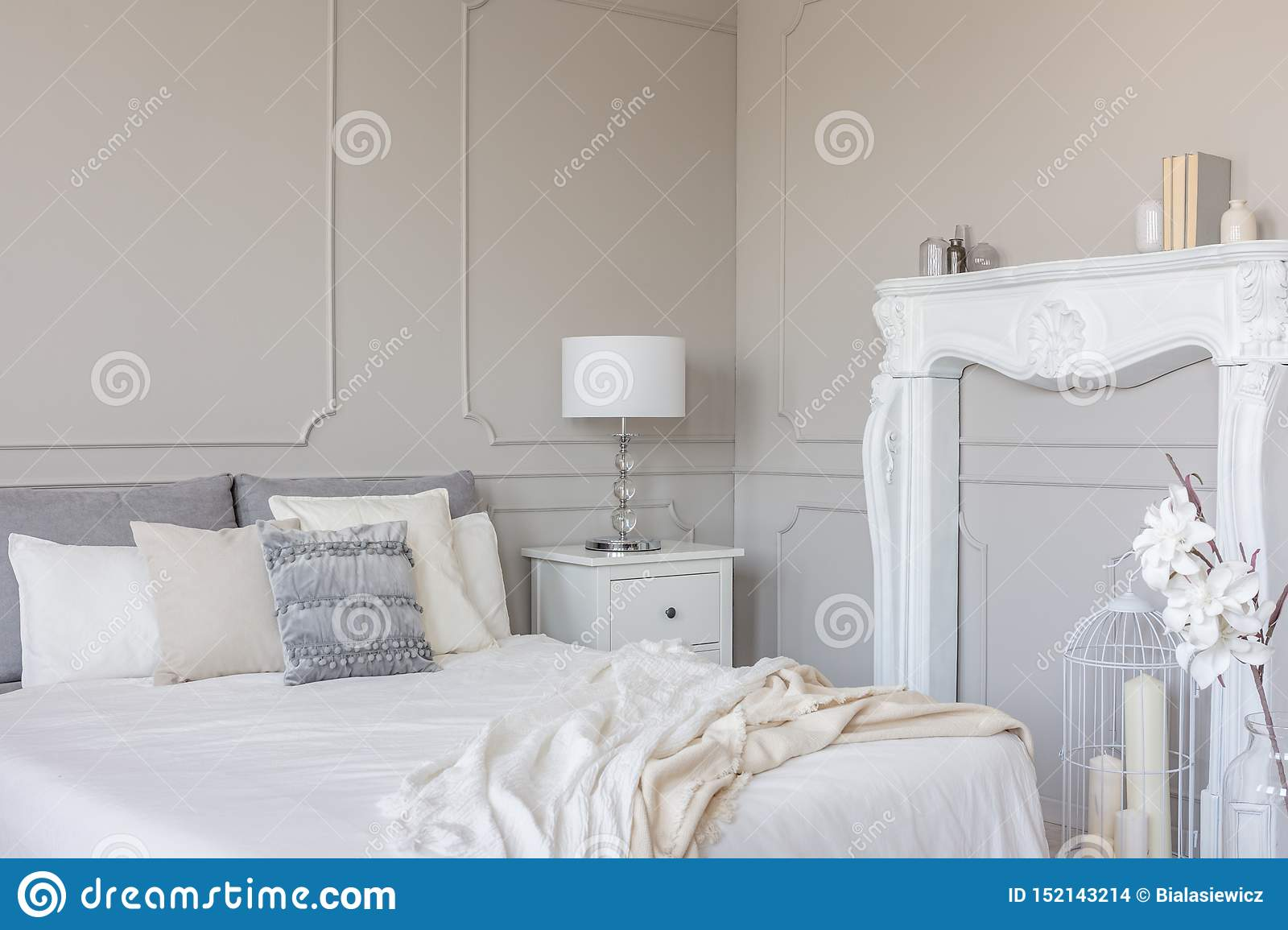 White Wooden Fireplace Portal In Beautiful Bedroom Interior With White Sheets On King Size Bed Stock Photo Image Of Duvet Estate 152143214