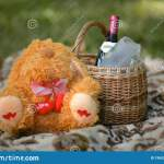 Wicker Basket With Picnic Set A Bottle Of Wine And A Teddy Bear Stock Photo Image Of Party Teddy 195935064