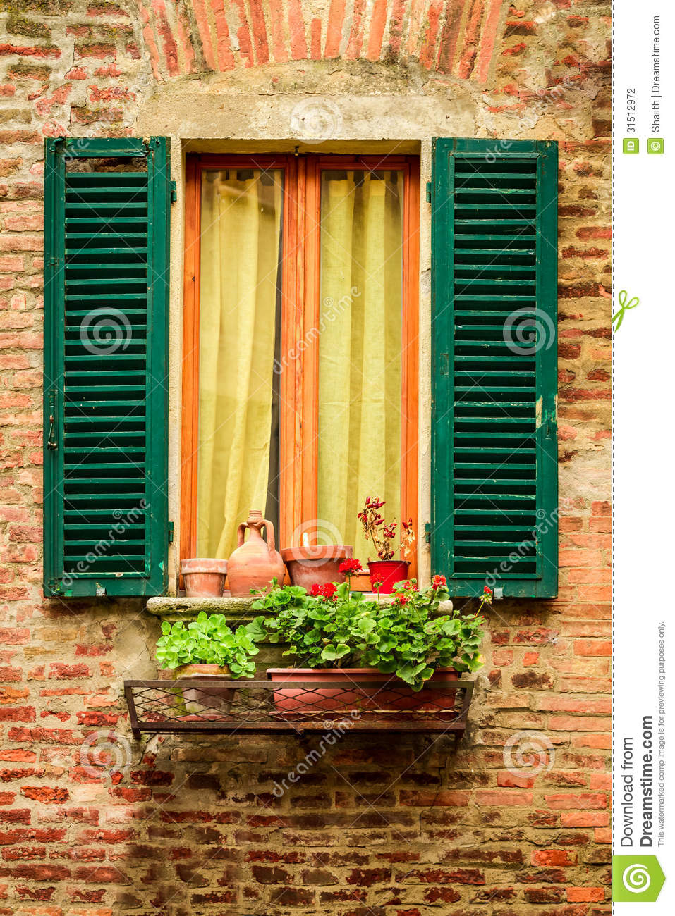 Window In An Old House Decorated With Flower Pots And