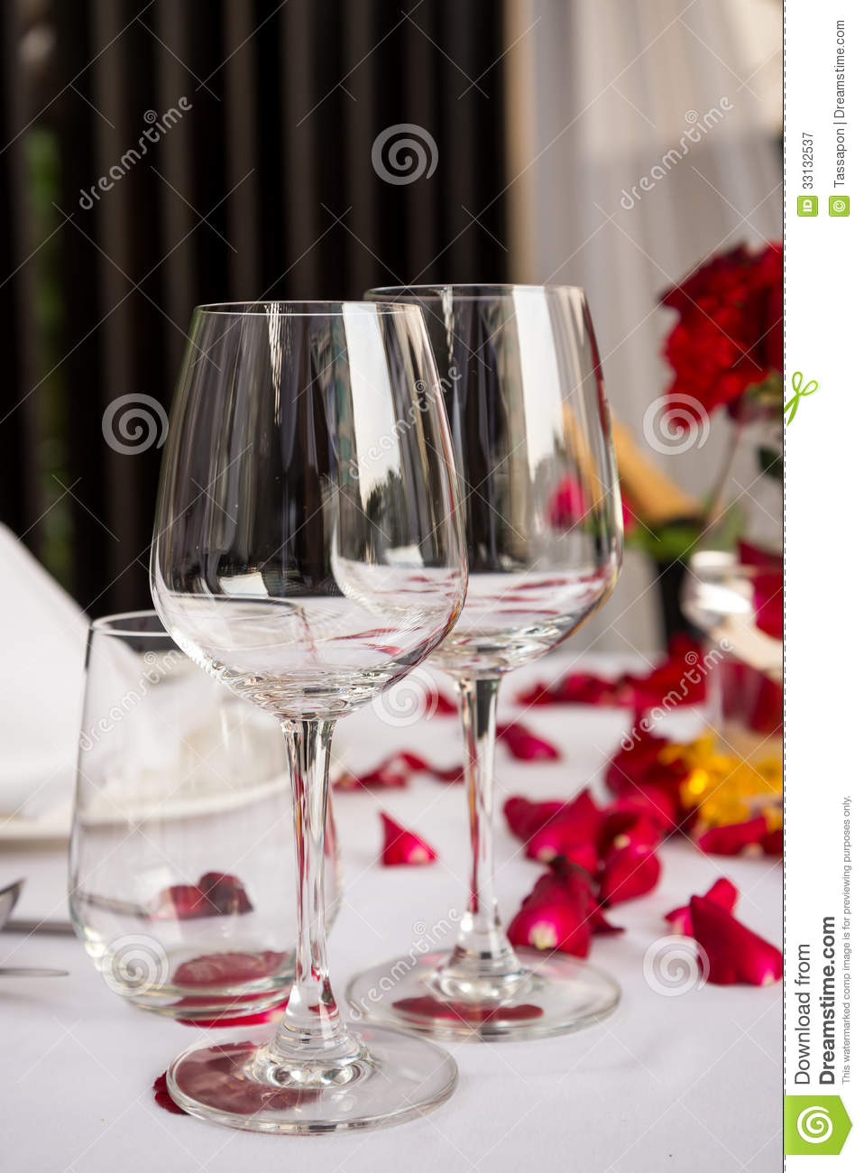 Wine Glass Table Set With Rose Petals Decorations Stock