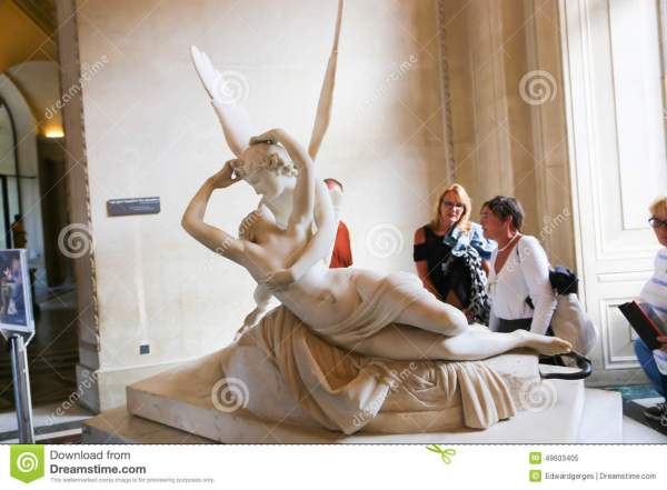 Woman With Angel Statue - Louvre Museum Paris Editorial 49603405