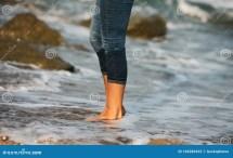 Woman Bare Foot Walking Beach Rocks Stock