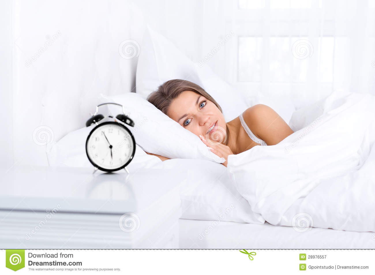 Woman In Bed Waking Up Royalty Free Stock Photography