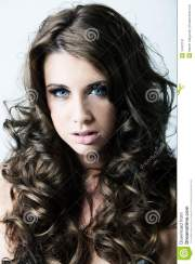 woman with blue eyes and long curly