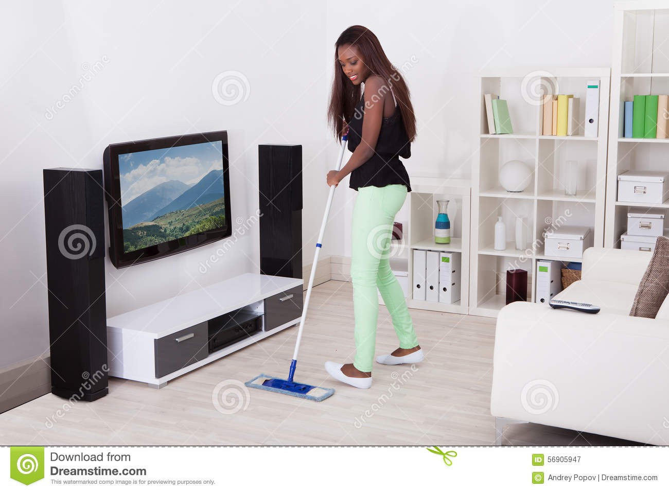 african living room wooden furniture philippines woman cleaning floor in stock photo - image ...