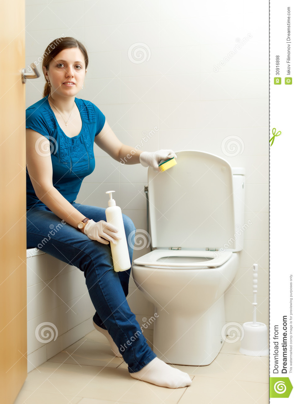 Woman Cleaning Toilet Bowl With Sponge Royalty Free Stock