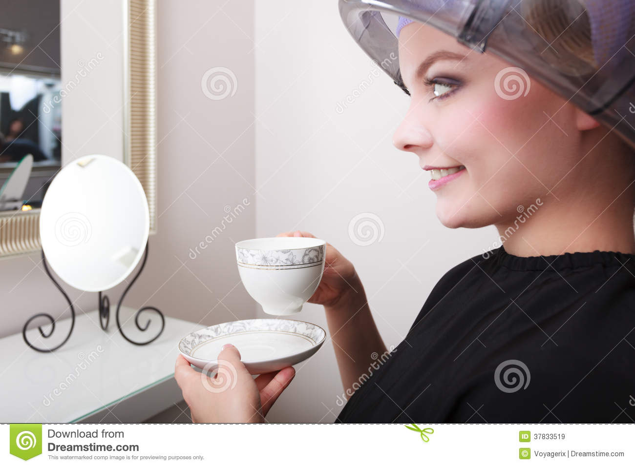 Woman Client Drinking Coffee Tea In Hairdressing Salon Girl In Hair Rollers Curlers With