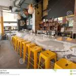 Woman Dining Inside Modern Cafe With Bar Counter And Many Bottles With Alcohol Editorial Stock Photo Image Of Interior Chairs 120034808