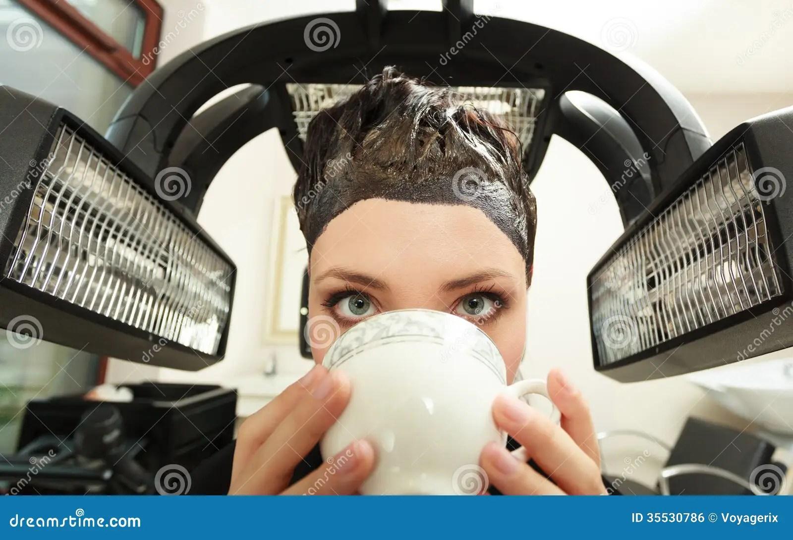 Woman Drinking Coffee Tea In Hair Beauty Salon By