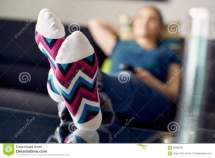 Woman With Feet Table Watching Film Tv Home Stock