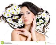 woman with flowers in hair stock