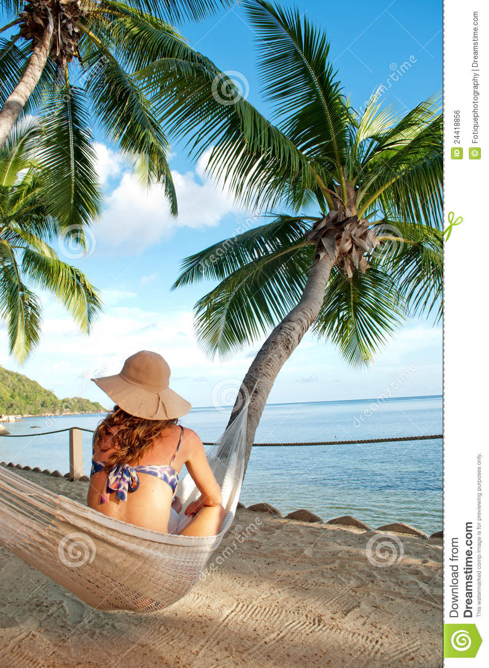 Woman On Hammock In Tropical Island Palm Trees Stock Photo