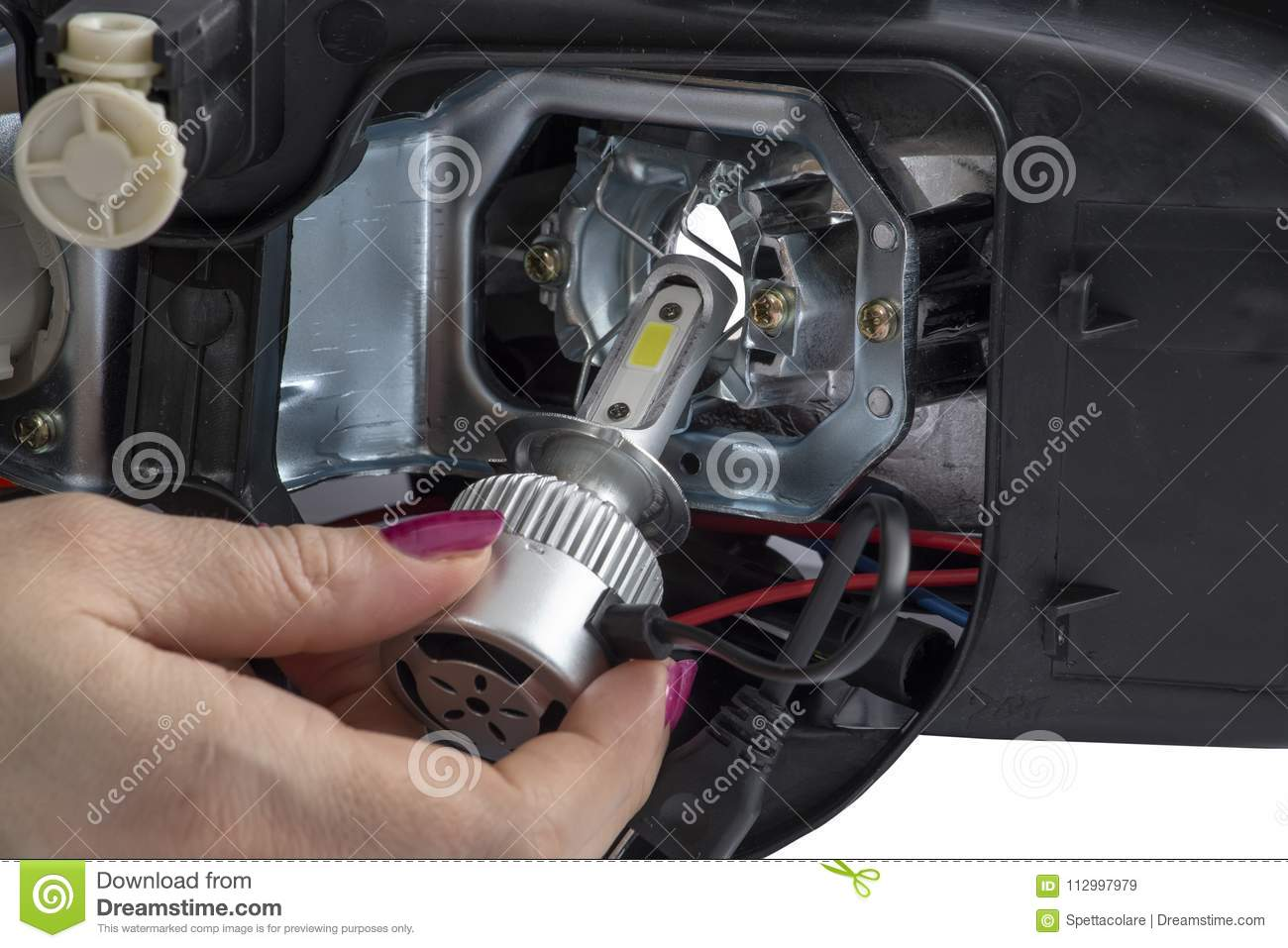 hight resolution of woman hand installing led headlight bulb with wires abstract modern car lighting technology