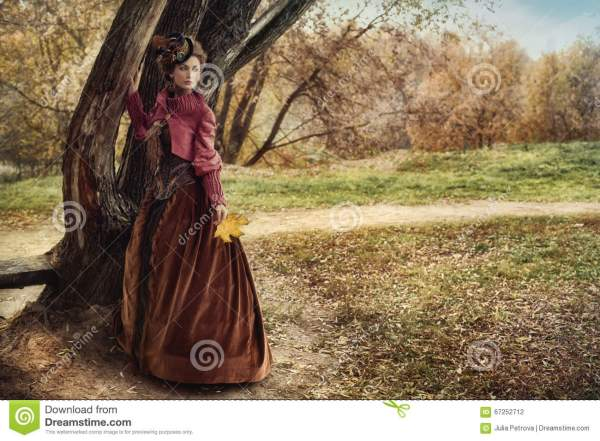 Woman In Historical Dress Tree Autumn Forest