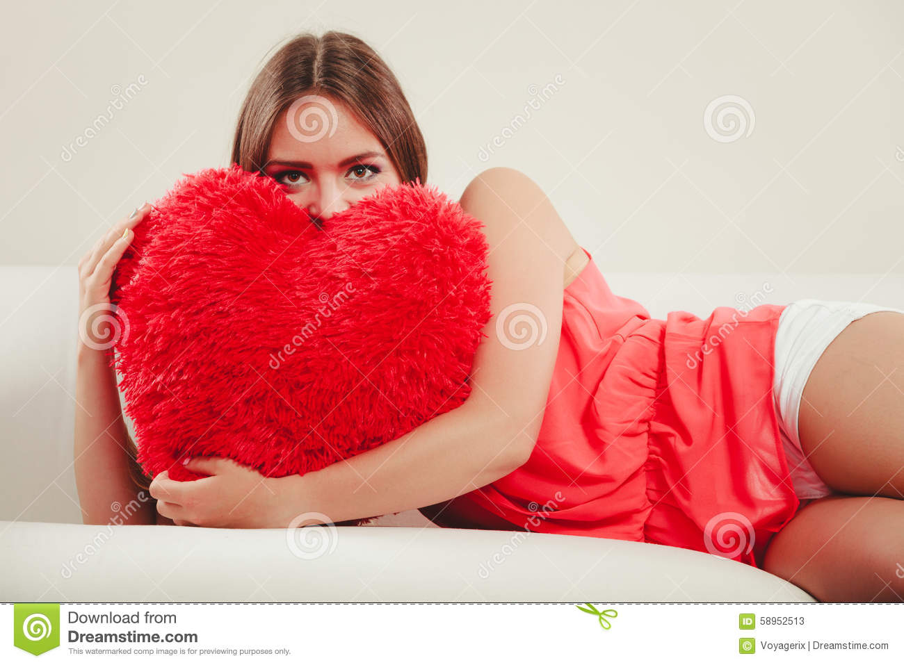 sitting pretty sofas macy furniture sofa sleepers woman hugging heart shape pillow valentines day stock