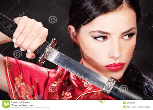 Woman And Katana Sword Royalty Free Stock