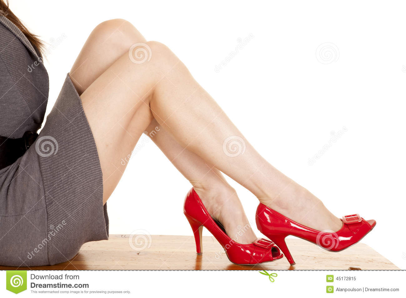 red heel chair desk target au woman legs sit gray dress heels stock photo image