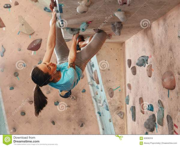 Woman Practicing In Climbing Gym Stock - 62836318
