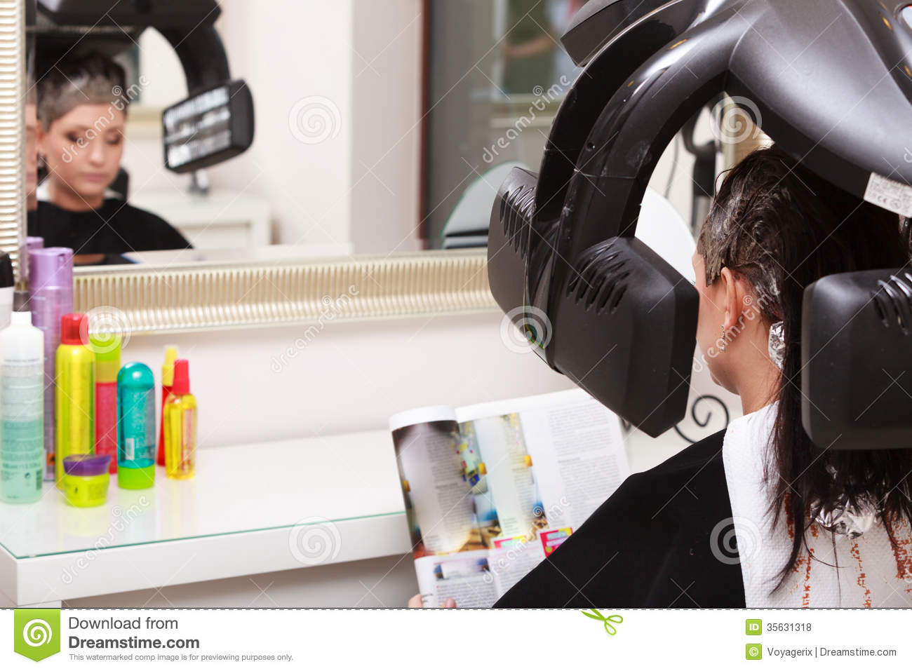 Woman Reading Magazine In Hair Beauty Salon By