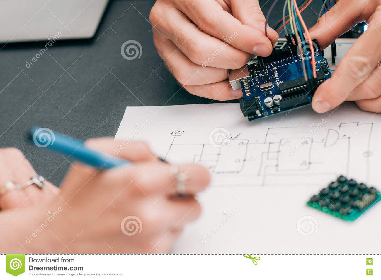 hight resolution of woman recapping electronics creation process engineer assistant drawing wiring diagram of electronic construction modern technologies innovation