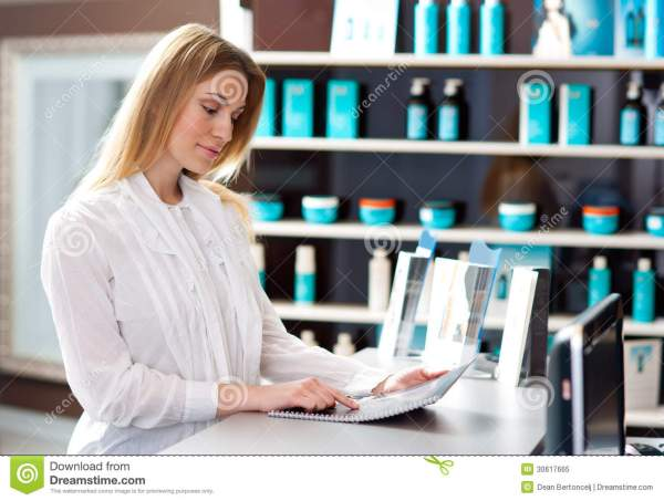 Woman In Reception Desk Royalty Free Stock