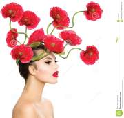 woman with red poppy flowers stock