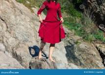 Women Walking Barefoot On Rocks