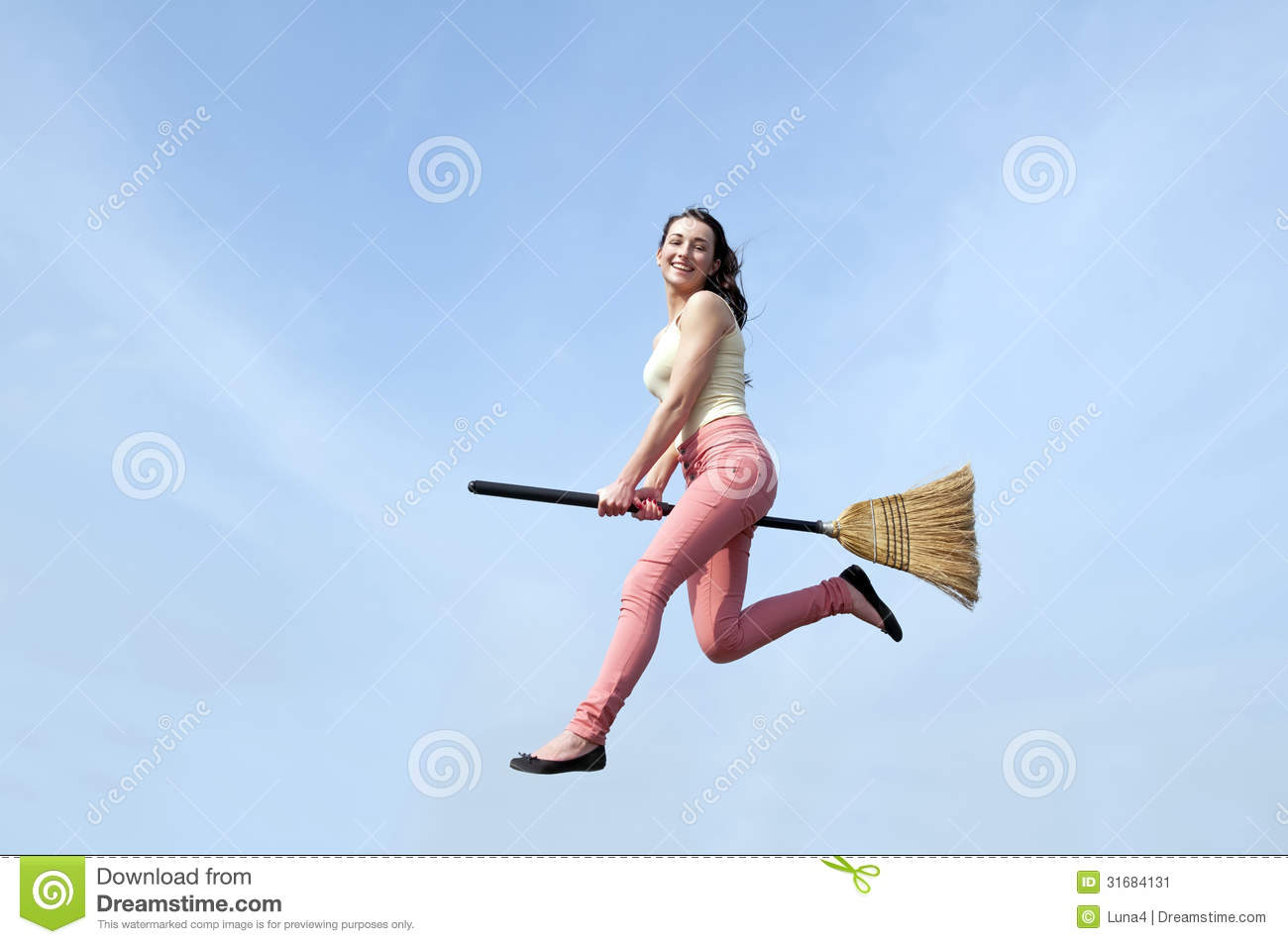 woman riding broom stock