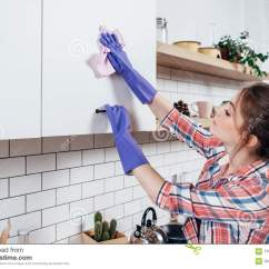 Cleaning Kitchen Cabinets Costco Aid Woman In Rubber Gloves Cabinet Stock Image