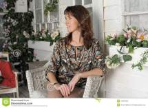 Woman Sitting In Wicker Chair Stock - 41037424